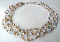 Vintage Style Triple Stranded Faux Pearl And Bead Necklace.